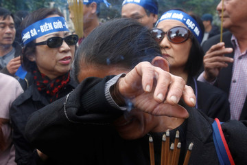 A woman cries while taking part in anti-China protest to mark the 38th anniversary of the China-Vietnam border war in Hanoi