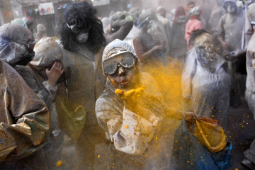 "Revellers celebrate ""Ash Monday"" by participating in a colourful ""flour war"", a traditional festivity marking the end of the carnival season and the start of the 40-day Lent period until the Orthodox Easter,in the port town of Galaxidi"