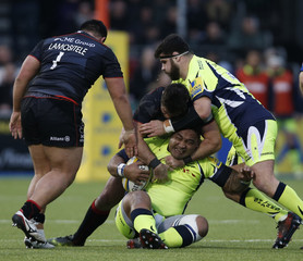 Sales' Halani Aulika is tackled by Saracens' Brad Barritt