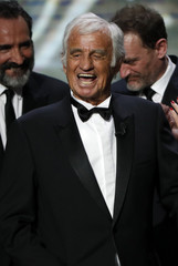 Actor Jean-Paul Belmondo reacts on stage as he receives an Honorary Cesar Award at the 42nd Cesar Awards ceremony in Paris