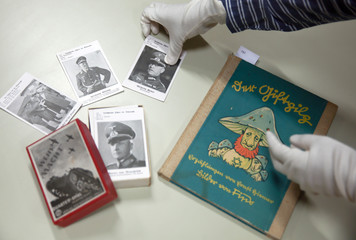 A Nazi children's book and a quartette card game are seen at the auction house Zisska and Lacher in Munich