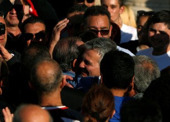 Former Maltese Prime Minister Gonzi embraces Opposition Leader Busuttil during a national protest against the government of Prime Minister Joseph Muscat, in Valletta