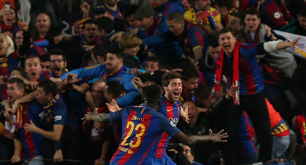 Barcelona's Sergi Roberto celebrates scoring their sixth goal with Samuel Umtiti