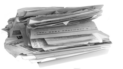 A stack of old newspapers isolated on white background