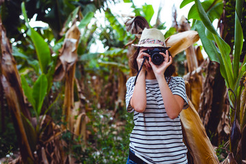girl with camera in the jungle