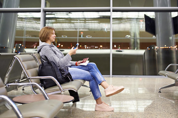 Woman with smartphone in airport