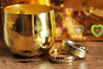 Two gold wedding rings with reflections, brilliant luxury