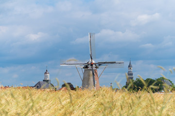 Wall Murals Mills wheat field with windmill