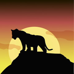 Illustration of a black silhouette of a lion on a rock.