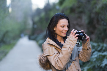 Tourist takes pictures in the surroundings of the Alhambra. Granada, Spain