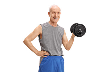Mature man exercising with a dumbbell