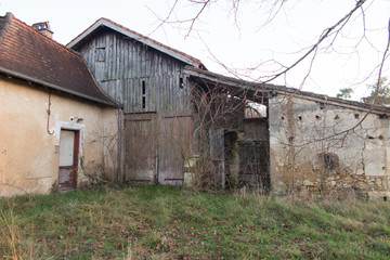 In the French countryside a house with a barn a little abandoned and rusty