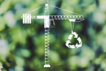 tower crane lifting up a recycle symbol,