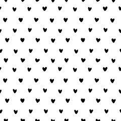 Hand drawn doodle small black ink hearts on white background. Seamless pattern. Vector illustration.