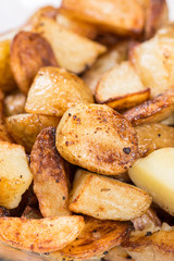 Macro closeup fried young potatoes with blurred background