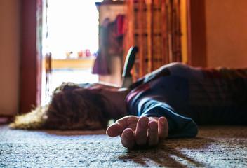 A victim of a crime lies dead in an apartment  - fototapety na wymiar