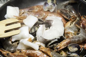 Preparing seafood for paella