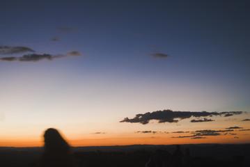 Girl silhouette at sunset in Brazil