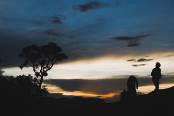 Men silhouette at sunset in Brazil