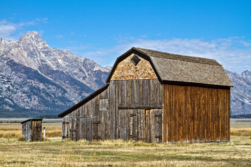 Wooden Barn and Outhouse In Front of Grand Teton Mountain Range