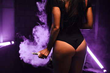 vapor concept,sexy young woman in lingerie vaping e-Cigarette