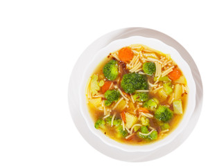 Fresh vegetable soup with noodles. top view. isolated on white