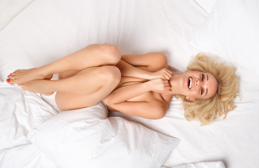 Portrait Happy girl naked body in bed.