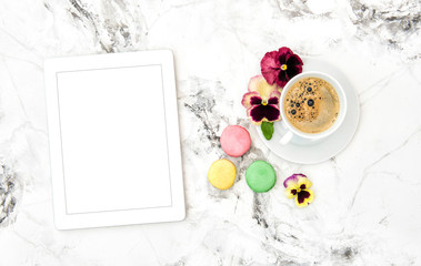 Tablet PC coffee cookies pansy flowers Floral flat lay