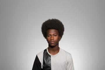 Studio portrait of a young man contemplating