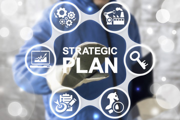 Strategic Plan Industrial Concept. Industry 4 planning and strategy. ERP enterprise strategies resource web finance manufacturing technology. Worker touched icon strategic plan word on virtual screen.