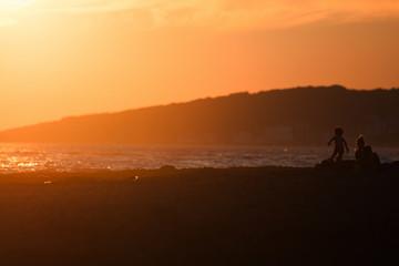 People on the beach sunset