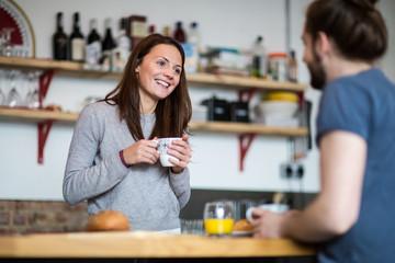 Young couple enjoying breakfast together