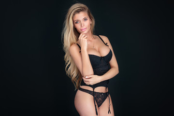 Sexy blonde woman in black lingerie.