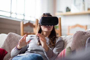 Young adult female using VR headset