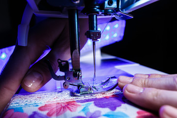 the theme of needlework , sewing, dressmaking, sewing machine