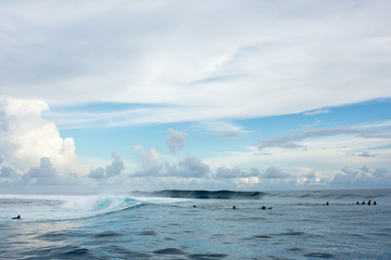 Large group of surfers floating on sea, Tahiti, South Pacific