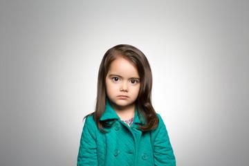 Studio portrait of a girl contemplating