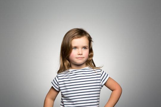 Girl standing against gray background