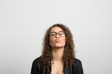 Studio portrait of a young woman having fun