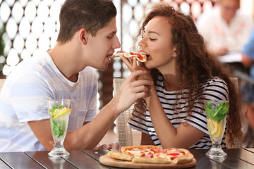 Lovely couple eating pizza