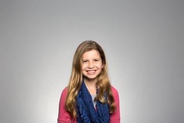 Studio portrait of a happy girl