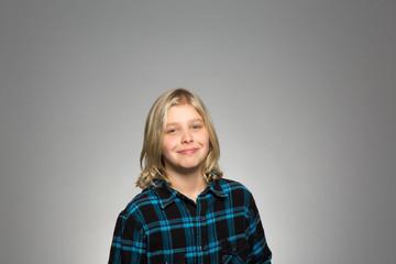 Studio portrait of a confident boy