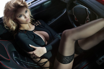 Sexy blonde girl in car.