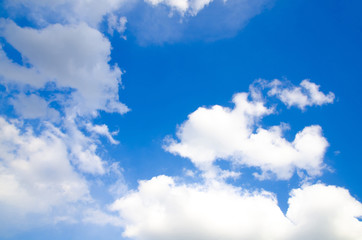 A bright blue sky with clouds of different colors.