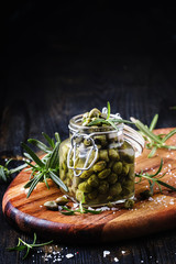 Salted capers in vinegar, shallow depth of field