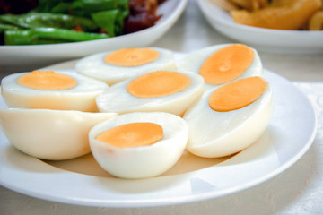 Halves boiled eggs on white dish