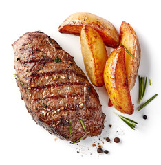 grilled beef steak and potatoes