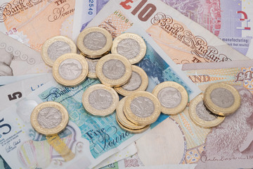UK money banknotes and pound coins