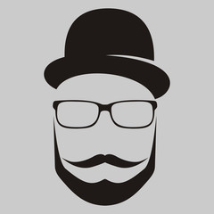 A man in a hat with a mustache , glasses and a beard