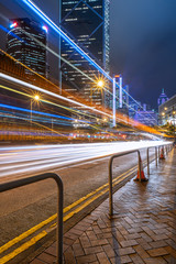 light trails on city street with cityscape at night in China.
